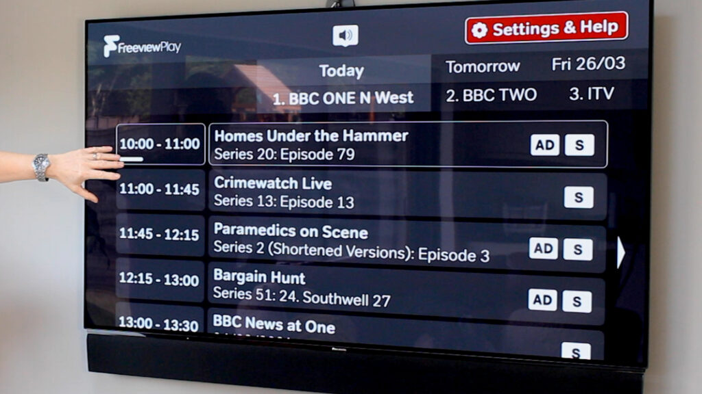 Accessible TV guide on screen, showing white text on black background