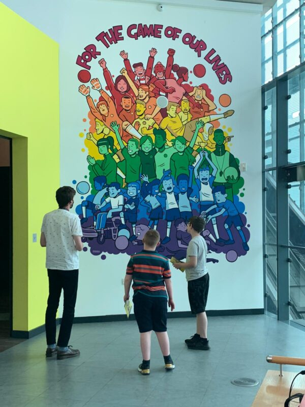 Children viewing the football mural at National Football Museum