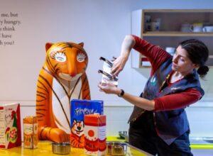 Tiger sculpture with Z Arts representative. Image credit- Z Arts
