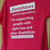 Back of Henshaws pink t-shirt with the logo written in white with the wording I'm supporting people with sight loss and other disabilities
