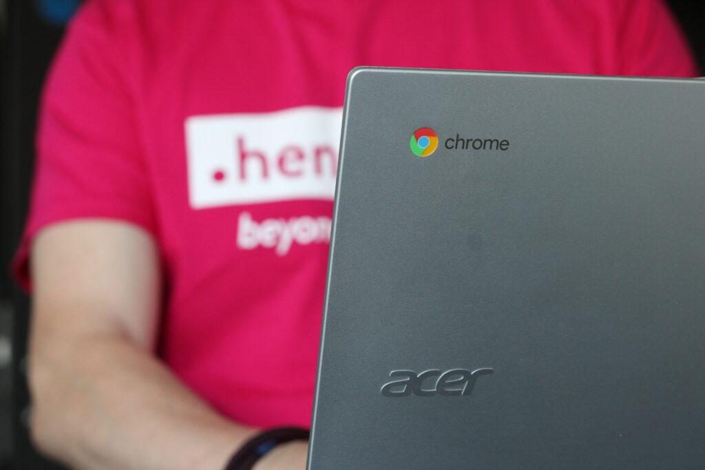 Chromebook with Henshaws user sat behind it