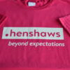Front view of pink Henshaws t shirt with logo in white