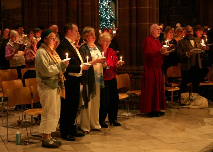 people singing carols at manchester cathedral